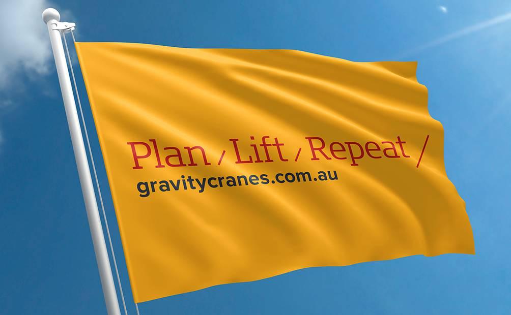 Gravity Cranes tagline on a flag